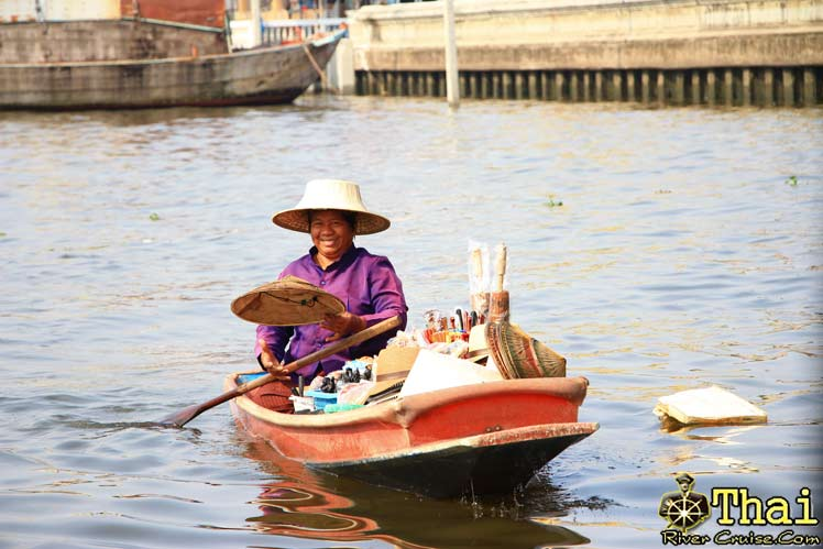 Merchant boats floating along the bangkok noi canal sell drink and souvenir to tourists. Bangkok Canal Tour