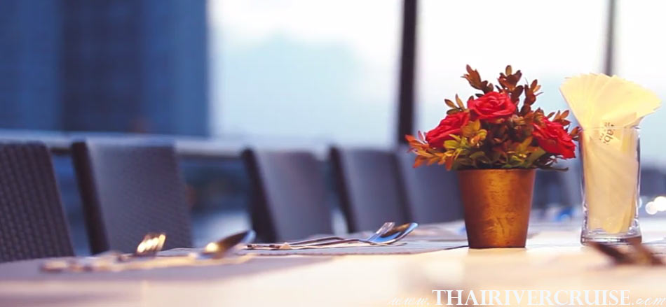 Beautiful table decoration on Boat Rentals Charters Private River Cruise in Bangkok Thailand, Enjoy to see good view to see scenery of Chao phraya river both side from upper deck of cruise.