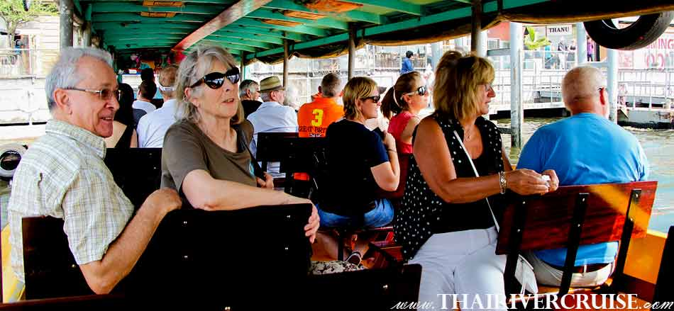 Tourists on Chao phraya river boat tour Bangkok with lunch