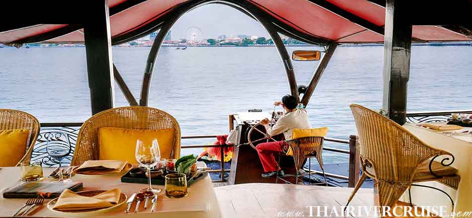 Enjoy to see the Chaophraya river views on Manohra Cruises Luxury Rice Barge New Year River Cruise Bangkok