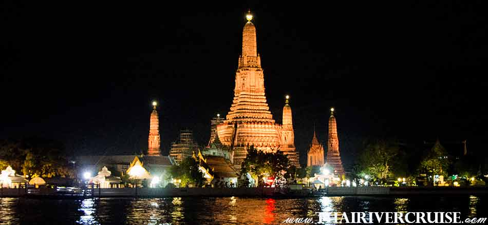 Temple of Dawn or Wat Arun ,The Beautiful Night Scenery Along the Chaophraya River Bangkok Thailand