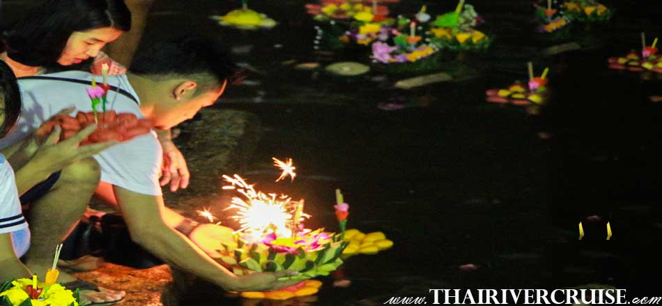 Thai people is floating the Kratong on Loykratong festival Bangkok Thailand