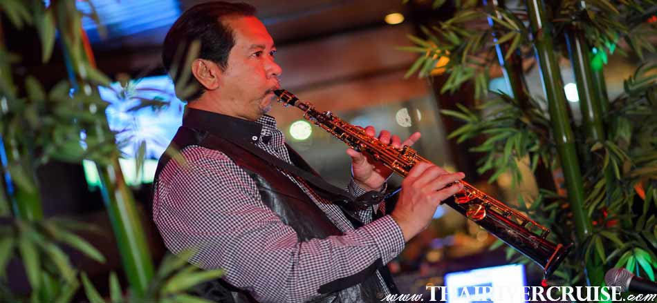 Saxophone Music in Jazz song,  Entertainment on board White Orchid River Cruise by Thai classical dancing cabaret show and live band music