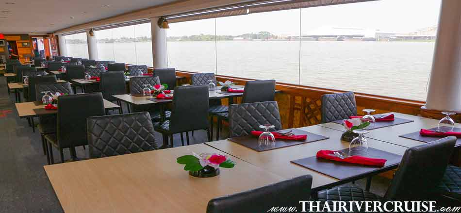 Air conditioned lower deck of White Orchid River Cruise Ayutthaya