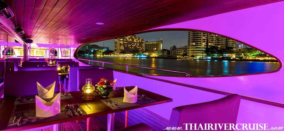 Romantic Candlelight window seats of Wonderful Pearl Cruise, luxury large elegance 5-stars dinner cruise Chaophraya river Bangkok Thailand