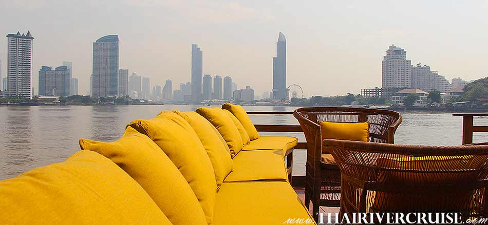 Enjoy to see the Bangkok city town view from the Boat with Rooms Bangkok Private luxury cruise rice barge 5-star 2 cabin boat on the Chaophraya river Bangkok Thailand.