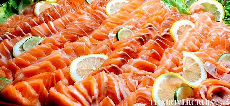 Delicious salmon sashimi in buffet dinner on Meridian Cruise Bangkok Dinner Cruise Chaophraya River